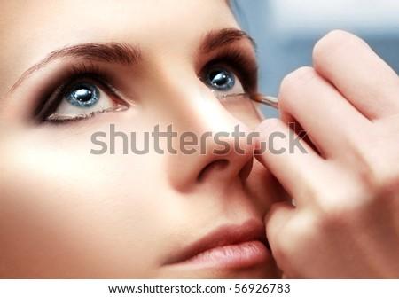 beautiful young woman in beauty-salon - stock photo