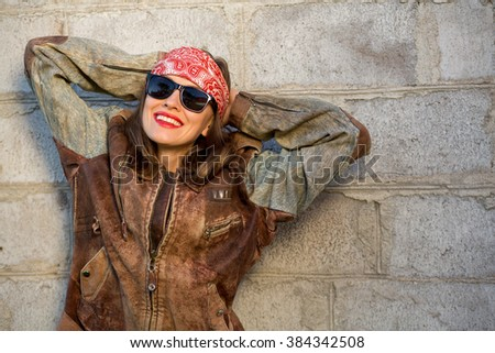 Beautiful young woman in biker jacket outdoor shot