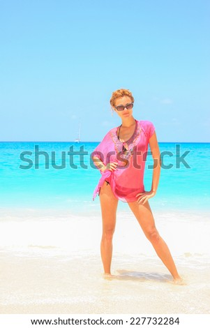 Beautiful young woman in bikini on the beach - stock photo