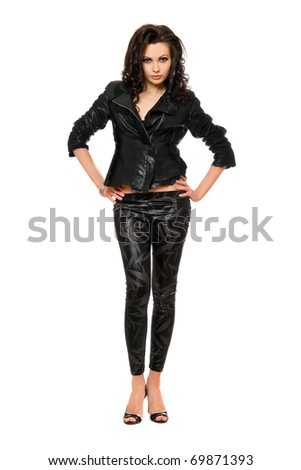 Beautiful young woman in black clothes. Isolated - stock photo