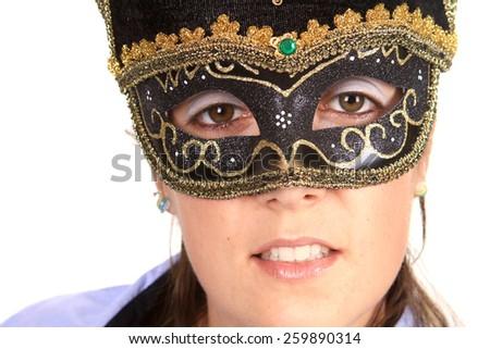 Beautiful young woman in black mysterious venetian mask - stock photo