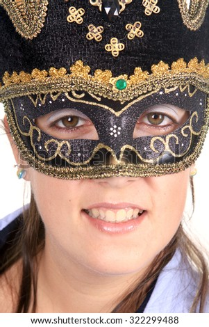 Beautiful young woman in black mysterious venetian mask - stock photo