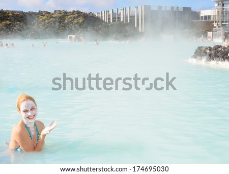 Beautiful young woman in Blue Lagoon geothermal spring , Iceland - stock photo