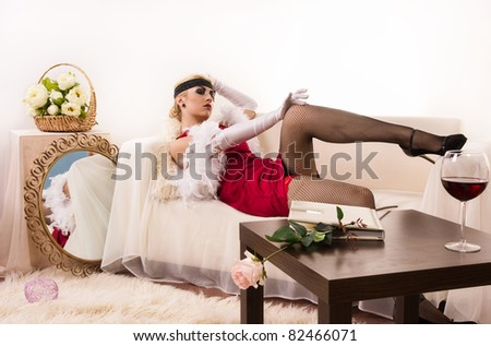Beautiful young woman in boudoir. Retro style - stock photo
