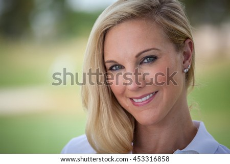 Beautiful young woman in casual attire outside close up with copy space