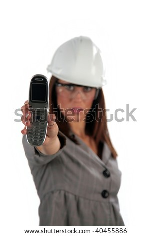 beautiful young woman in contractor hard hat with her cell phone, isolated on white - stock photo