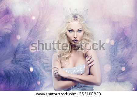 Beautiful young woman in crown and silver top over frozen bokeh background. Winter queen. Copy space. - stock photo
