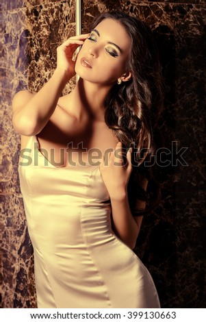 Beautiful young woman in elegant evening dress. Fashion shot. Hairstyle.
