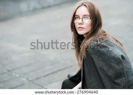 beautiful young woman in fashionable sunglasses resting during lunch - stock photo