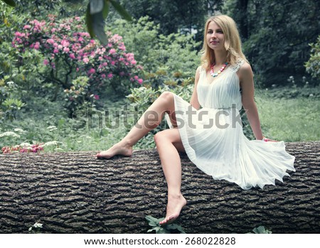 beautiful young woman in forest - stock photo