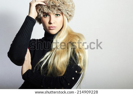 Beautiful Young Woman in Fur Hat. Pretty Blond Girl. Winter Fashion Beauty.Healthy hair - stock photo
