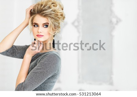 Beautiful young woman in gray dress