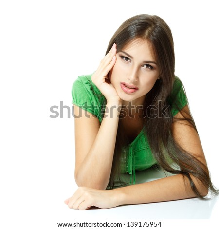Beautiful young woman in green shirt. Isolated on white background - stock photo