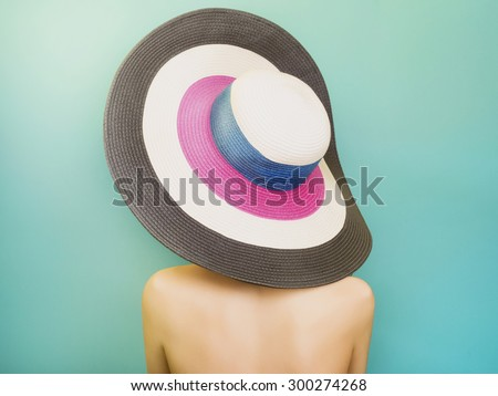 Beautiful young Woman in Hat drink soda. Fashion portrait. Elegance Beauty Girl with blue hair. colorful hat - stock photo
