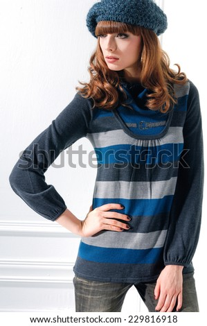 Beautiful young woman in jeans with hat pose - isolated in studio - stock photo
