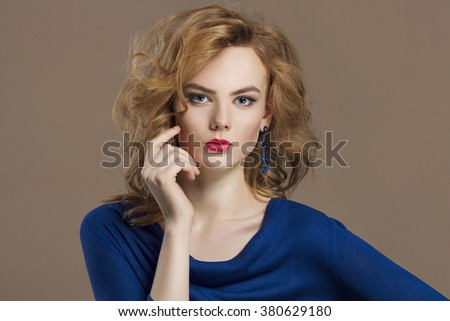 beautiful young woman in jewelry. Healthy hair beauty girl with make-up - stock photo