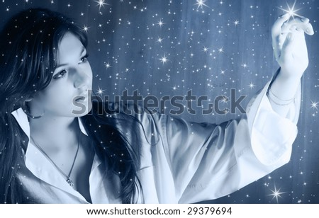Beautiful young woman in moonlight - stock photo