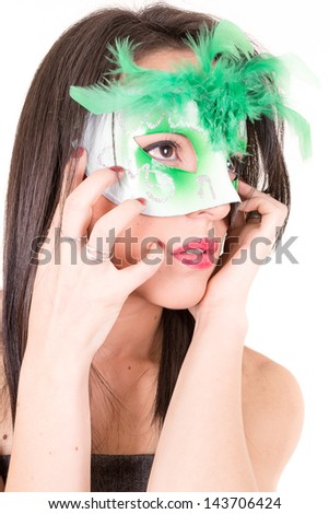 Beautiful young woman in mysterious venetian mask. Fashion photo