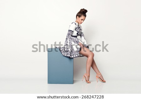 beautiful young  woman in nice spring dress, posing in studio. Fashion photo - stock photo