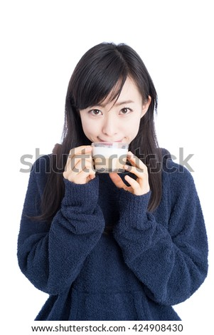 Beautiful young woman in pajamas drinking coffee isolated on white background - stock photo