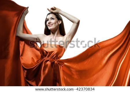 beautiful young woman in red long dress - stock photo