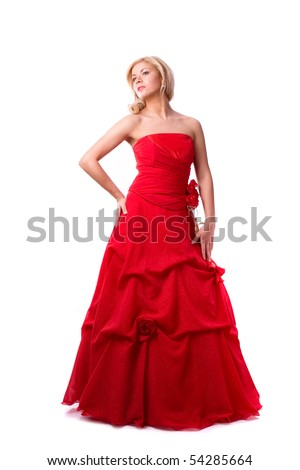 Beautiful young woman in red long dress . Girl in red dress full-length.  Happy woman in red prom dress.
