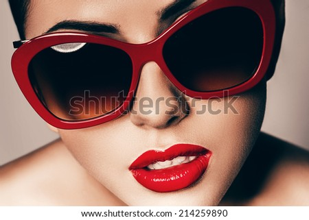 beautiful young woman in red sunglasses