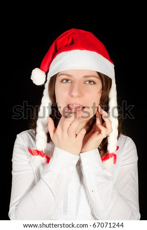Beautiful young woman in red wearing santa hat. - stock photo