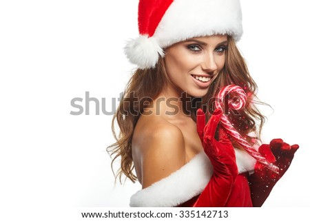 Beautiful young woman in Santa Claus clothes over white background.