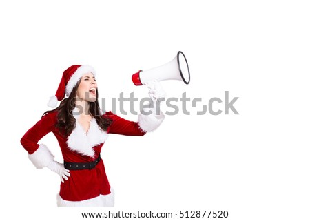 Beautiful young woman in Santa Claus clothes screaming
