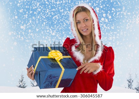 Beautiful young woman in Santa Claus clothes  with gifts on snowing  background