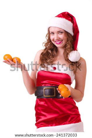 Beautiful young woman in Santa Claus clothes with orange mandarin on white background.