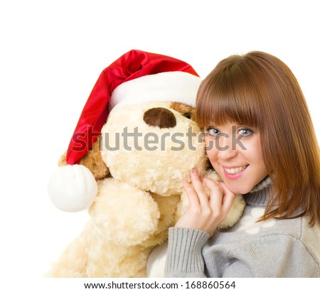 Beautiful young woman in Santa Claus clothes with toy dog on white background. - stock photo