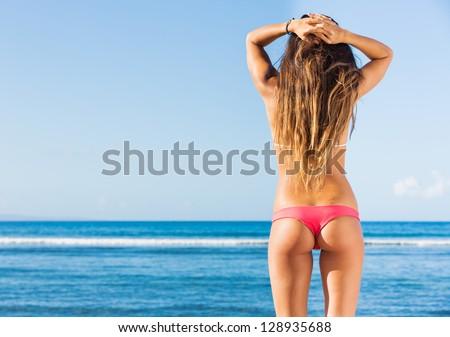 beautiful young woman in sexy bikini at the beach - stock photo