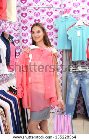 Beautiful young woman in shop