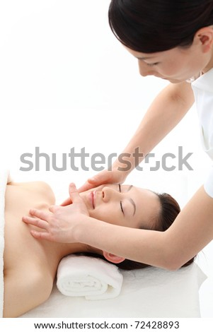 Beautiful young woman in spa. - stock photo