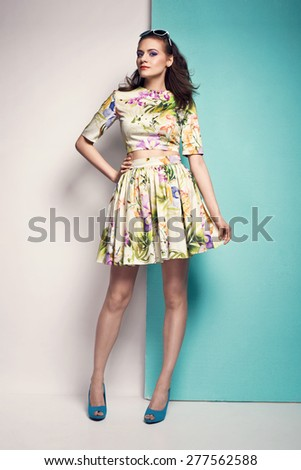 beautiful young woman in spring dress, sunglasses, high heels. Fashion photo - stock photo