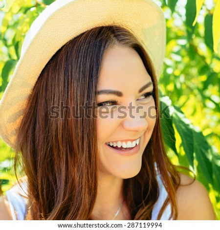 Beautiful young woman in stylish hat and jeans shorts posing. Hipster style. Summer time. girl with long hair poses in warm spring day .Photo with instagram style filters - stock photo