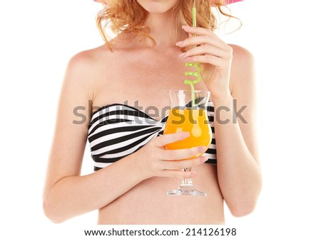 Beautiful young woman in swimsuit and hat with cocktail isolated on white