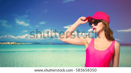 beautiful young woman in swimsuit standing on the wonderful seaside background