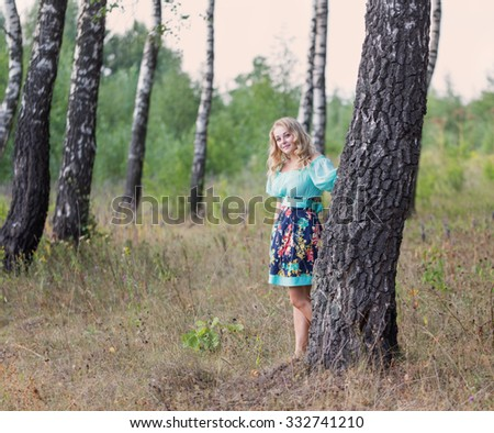 beautiful young woman in the birch forest