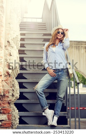 Beautiful young woman in the city. Jeans style. Fashion. - stock photo
