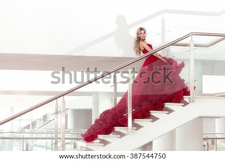 Beautiful young woman in the luxury red dress