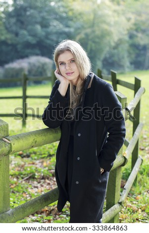 Beautiful young woman in the park in autumn