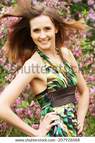 beautiful young  woman in the park on a warm summer day