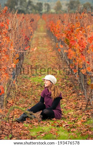 Beautiful young woman in the vineyard - stock photo