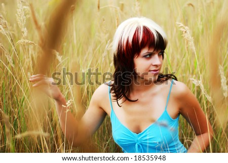 beautiful young woman in tne dry grass