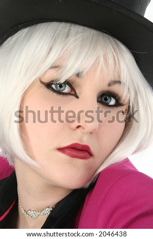 Beautiful young woman in top hat.  White hair and blue eyes. - stock photo