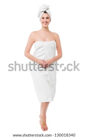 Beautiful young woman in towel all ready to get spa treatment. - stock photo