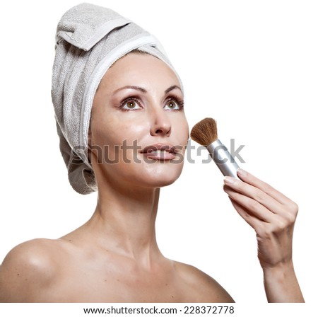 beautiful young woman in towel with a brush for a make-up - stock photo